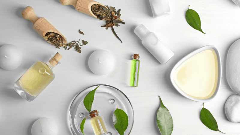 Essential oil products on a white background