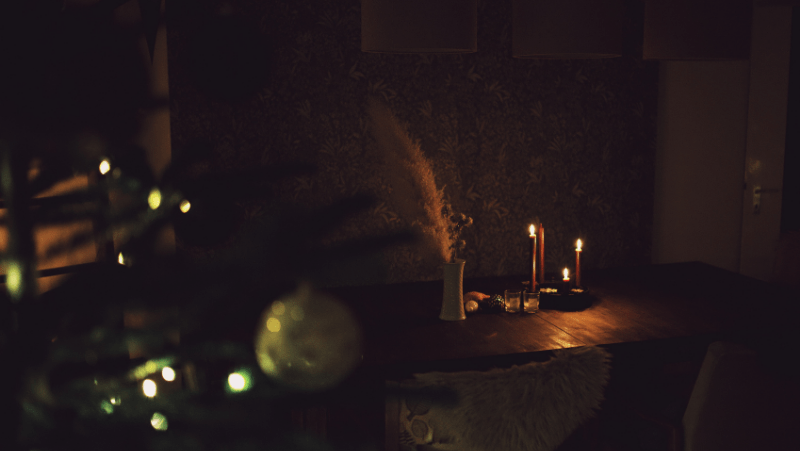 Decorative image of a candle lit dining table during winter.