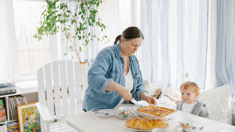 Decorative image of a mom or grandma making delicious food with a toddler