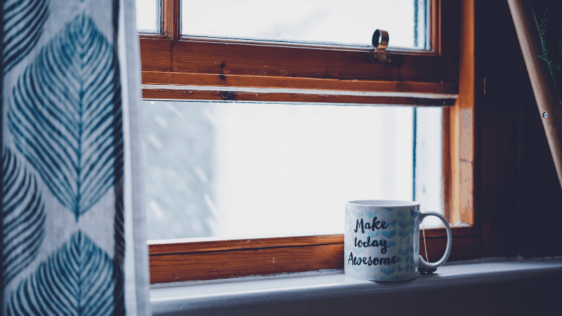 "Decorative image of a coffee cup by a window. The coffee cup says ""make today awesome""."