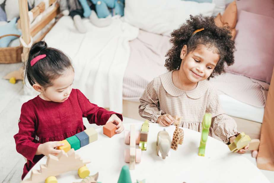 girls playing on a white table. hygge Christmas ideas