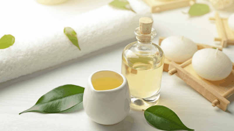 Self care products like essential oils, tea tree oil, and candles