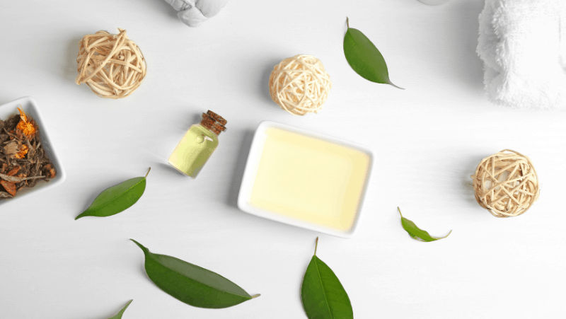 Self care products for stress relief like candles and tea tree oil